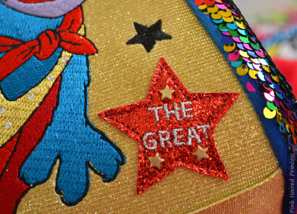 red glitter embroidered applique star on handbag