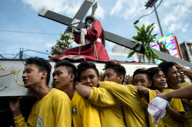 The annual procession of the Black Nazarene in the Philippines attracts devout Catholics eager to kiss or wipe the icon with white towels