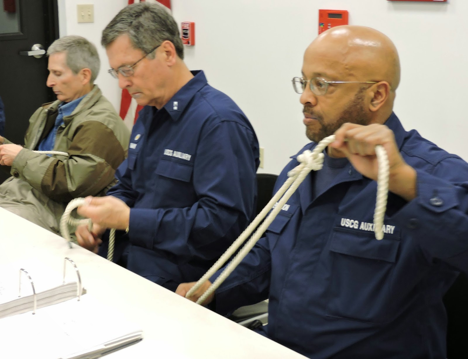 David Witherspoon, right, completes a bowline knot as Bill Iwanyk watches an Instructor demonstrate the knot.