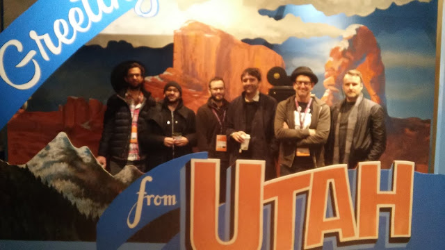 After one of our events held at the Utah Film Commission Hub filmmakers (L to R) Kerem Sanga (First Girl I Loved), Mario Campos (Christine), Clay Tweel (Gleason), Andrew Neel (Goat), Jeff Feuerzeig) and Steven Kajak (We are X) pose in the Utah Postcard set.