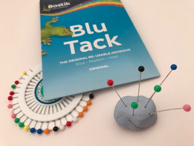 Blu Tack holding pins together