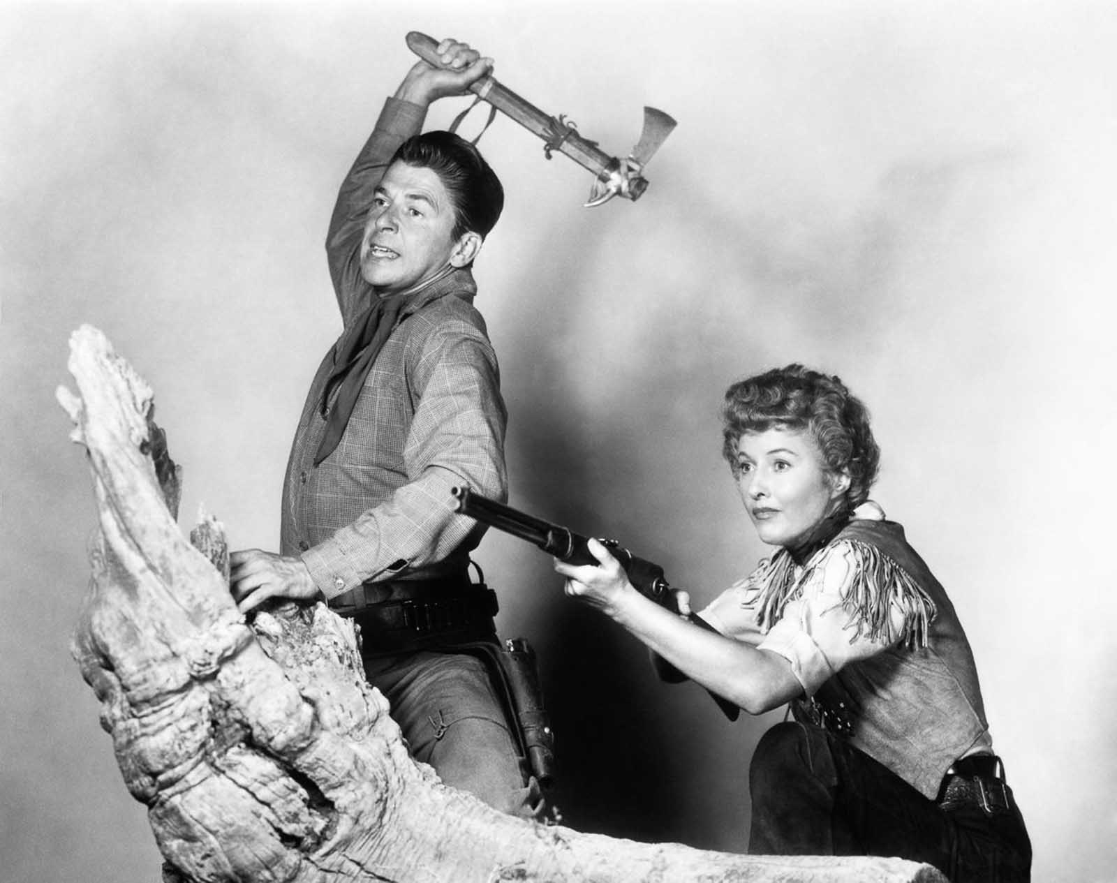 Ronald Reagan and Barbara Stanwyck in a publicity still for Cattle Queen of Montana.