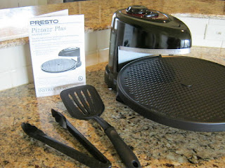 Presto Pizzazz Plus Rotating Oven with Instruction Book. Utensils not included.