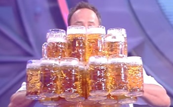 Most beer steins carried over 40 m / Guinness World Records Italian Show