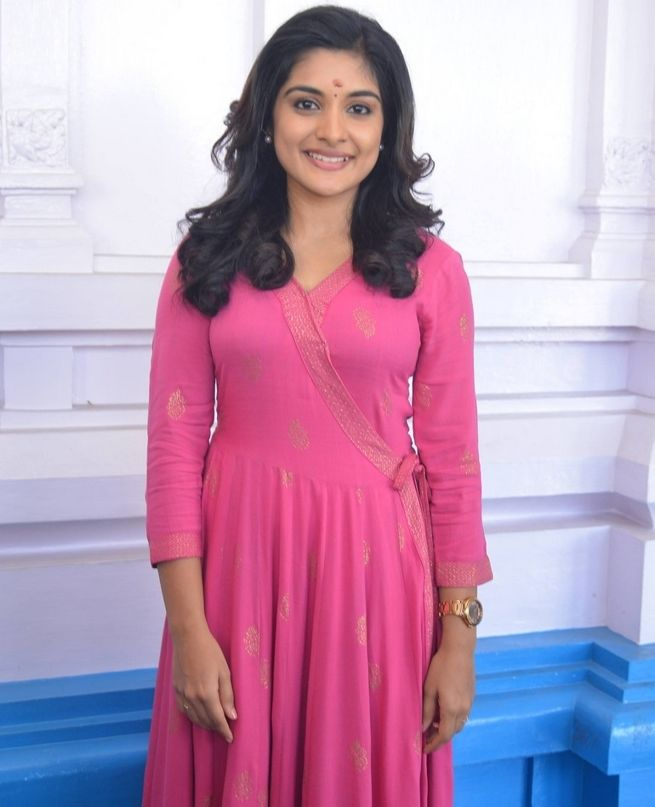 Actress Niveda Thomas New Telugu Movie Launch Photos In Pink Dress