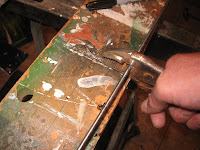 Use a wire cutter or Dremel tool to cut the rods