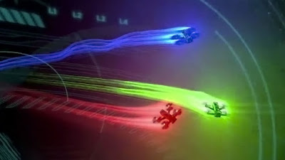 Three Racing Drones Flying