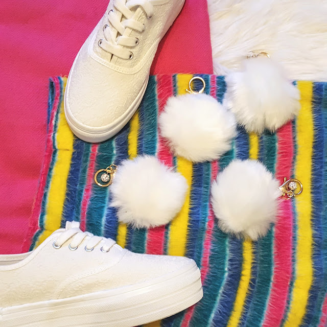 white platform sneakers and pom pom keychains