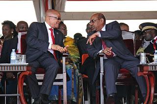 South Africa's President Jacob Zuma, left, speaks with Sudan's President Omar al-Bashir