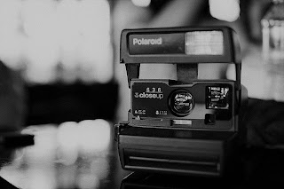 polaroid camera on table