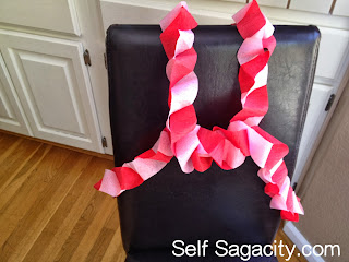 The finished look of pink and red paper garland