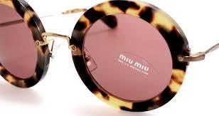 Foto di occhiali da sole a montatura tonda Miu Miu