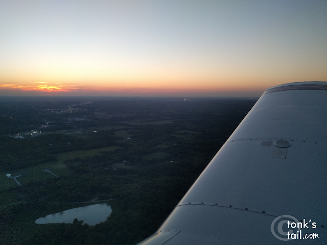 On right downwind at KLXT, coming in for a touch-and-go at sunset