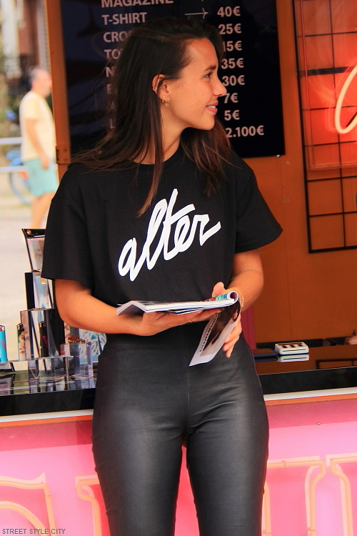 woman wearing leather pants legging and alter t-shirt