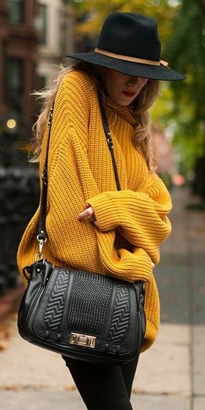 what to wear with a yellow oversized sweater : hat + bag + black skinnies