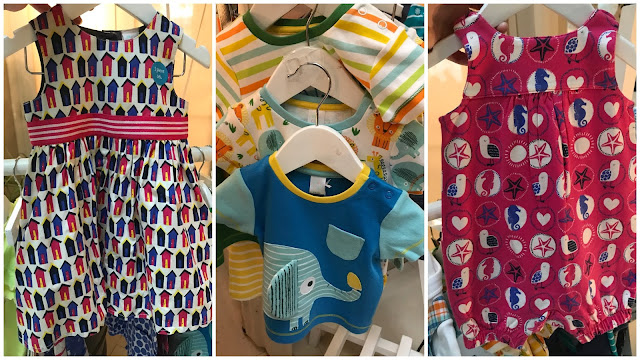 A pink and purple dress with beach huts on, a three pack of t-shirts featuring an elephant and other jungle animals and a pink romper with starfish, seahorses and sea gulls from mini club baby collection