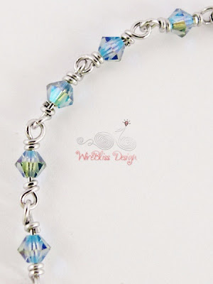 Close up of Wire Wrapped Minima Bracelet (Minlet) with 4mm Blue Swarovski Crystals