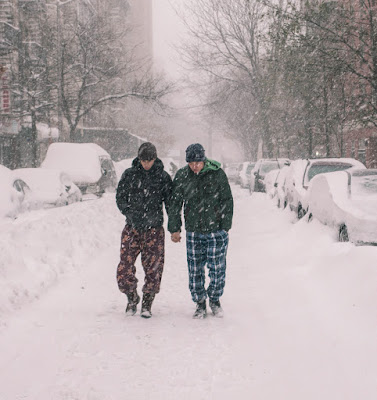 Gay couple on a stroll in blizzard-stricken NYC. Love keeps them warm. Jan. 2016