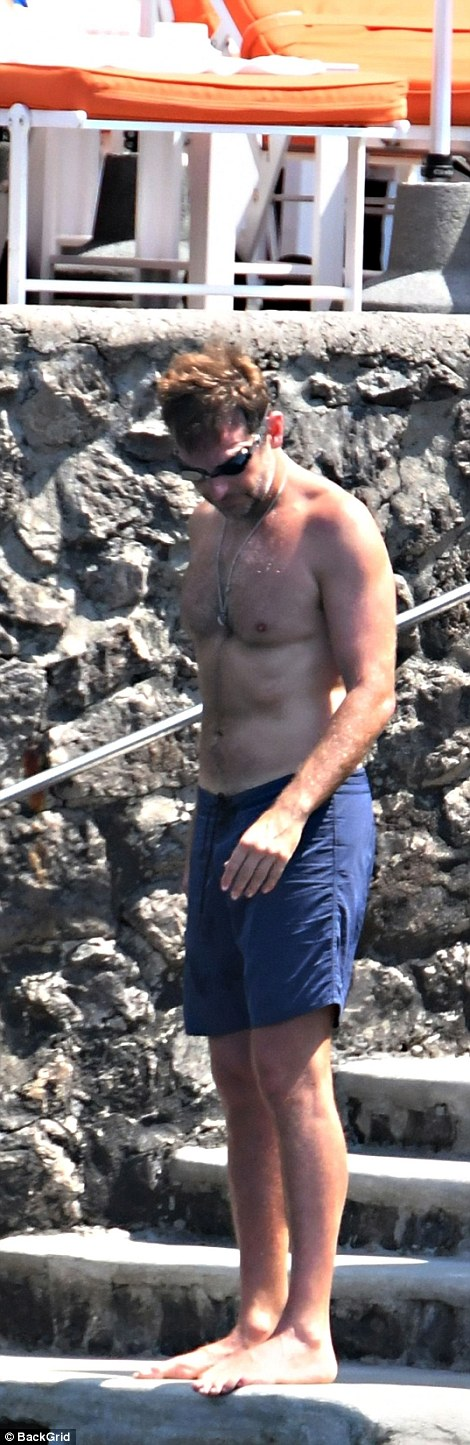 More photos of Irina Shayk and Bradley Cooper as they soak up the sun during romantic getaway in Italy