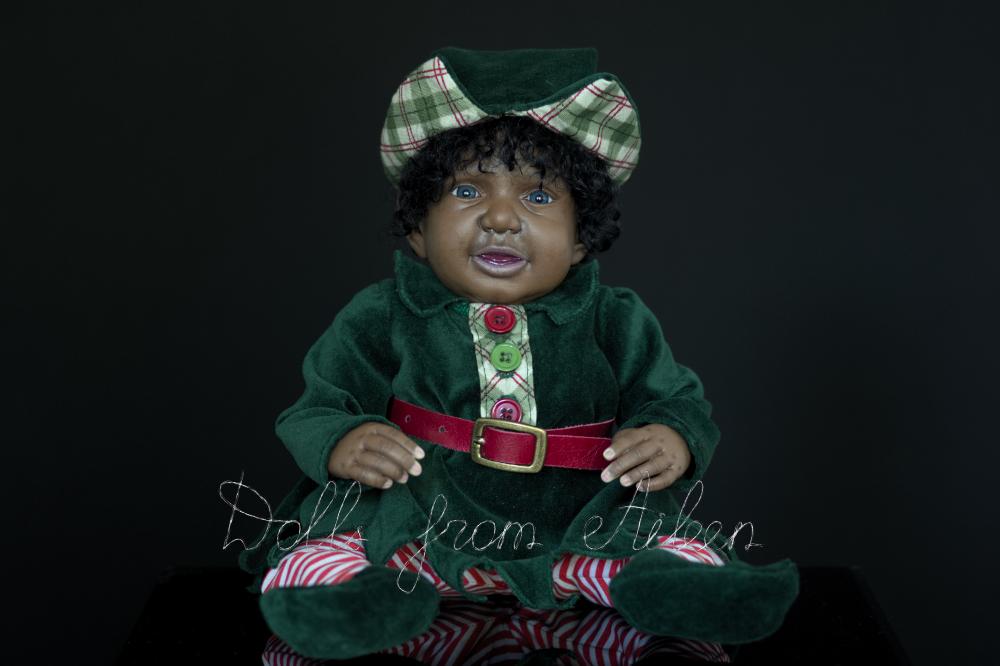 ooak Christmas elf art doll looking at camera