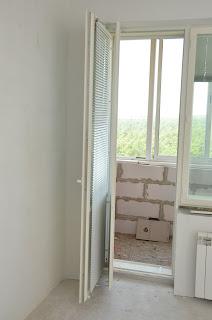 Дерево-алюминиевая балконная дверь Fenestra