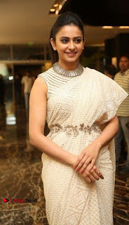 Actress Rakul Preet Singh Stills in White Dress at Winner Pre Release Function  0014.jpg
