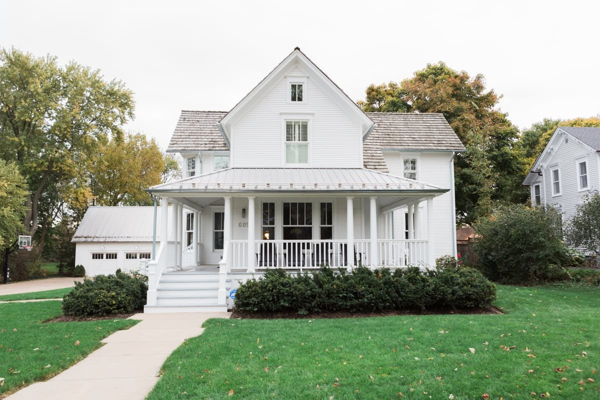 Beautiful white modern farmhouse with front porch on Hello Lovely Studio