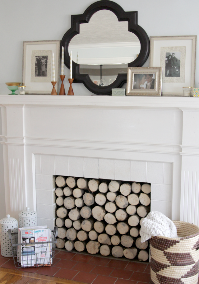 Stacked log firseplace insert to create a cozy farmhouse look for fall