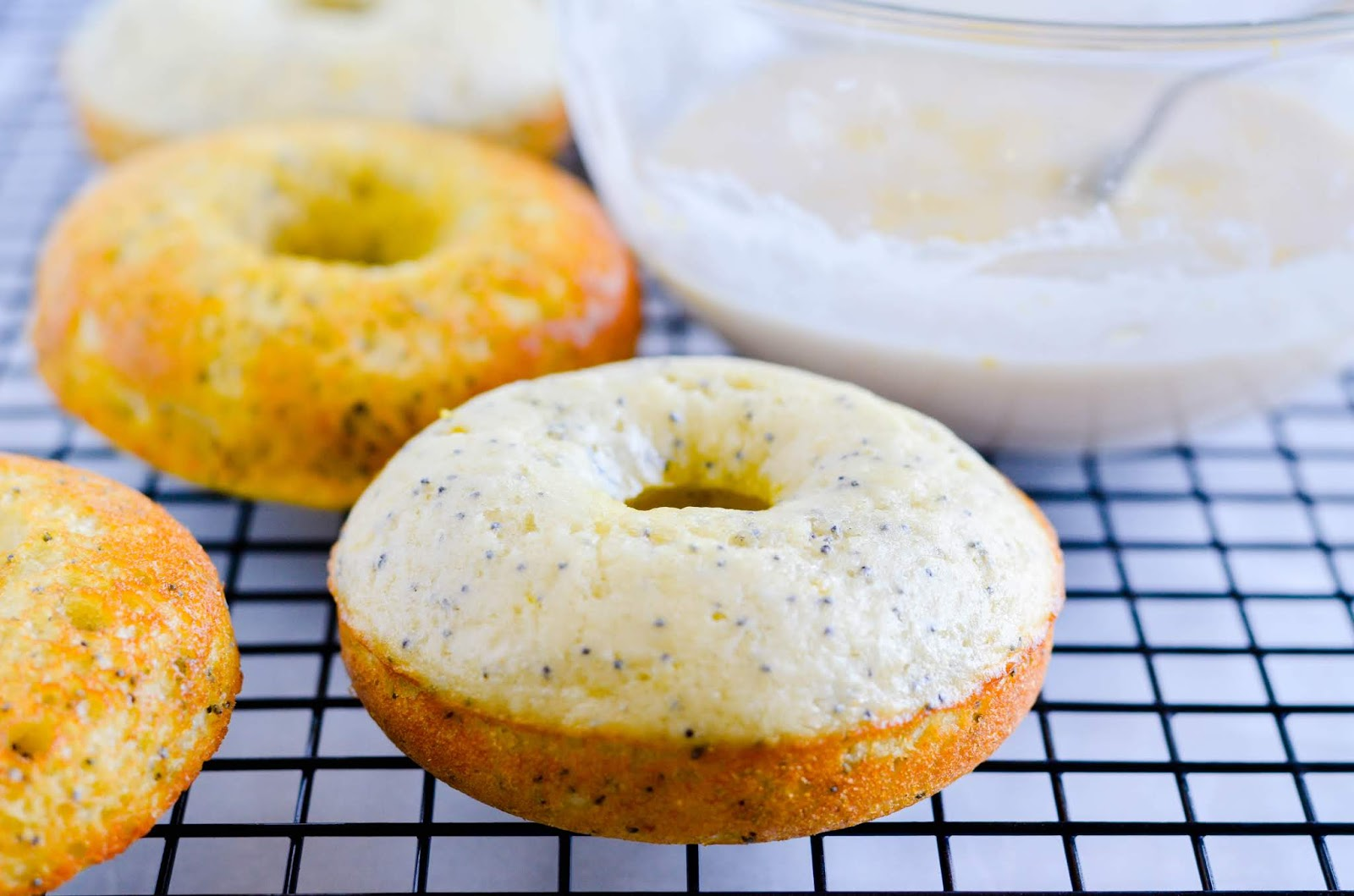 These Lemon Poppyseed Donuts have a moist, tender crumb and are bursting with lemon flavor! Plus, they're baked. Which means they are super easy!