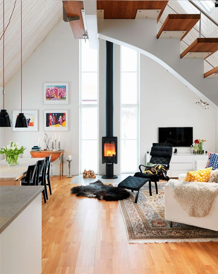 The well appointed catwalk 13 modern rooms with wood - Living room with wood burning stove ...