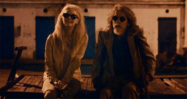 Eve and Marlowe (John Hurt) don't mind relaxing after living for so many years.