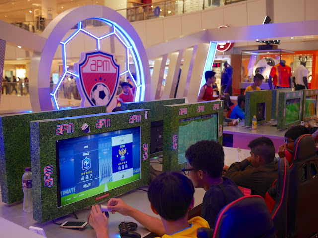 playing soccer video game at apm Hong Kong