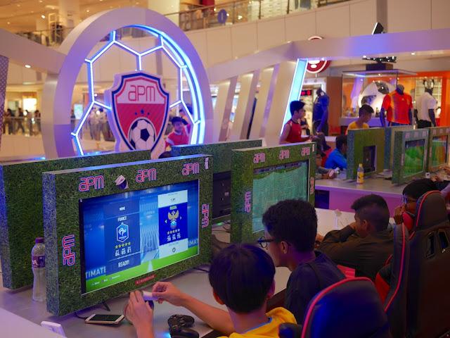 playing soccer video game at apm Hong Kong