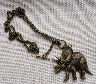Horned triceratops dinosaur necklace in brass