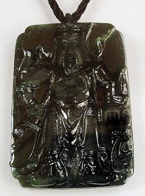 Black jade pendant with caved warrior
