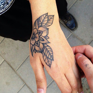 Small Tattoo Design With Flower and Leaf
