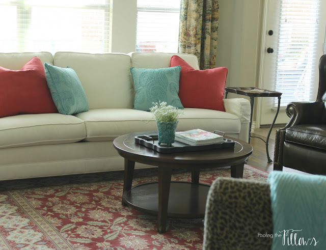 Adding robin's egg blue to our family room at Poofing the Pillows.
