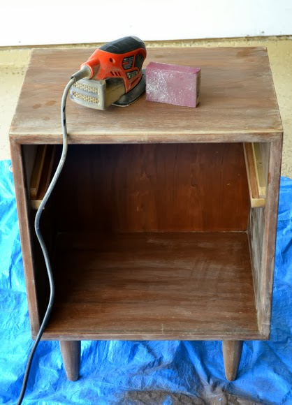 Sanding wooden nightstand
