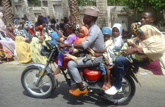 okada man carries six children