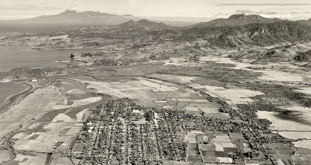 The town of Nasugbu during the American era, with the airfield visible from the air.  Image source:  United States National Archives.