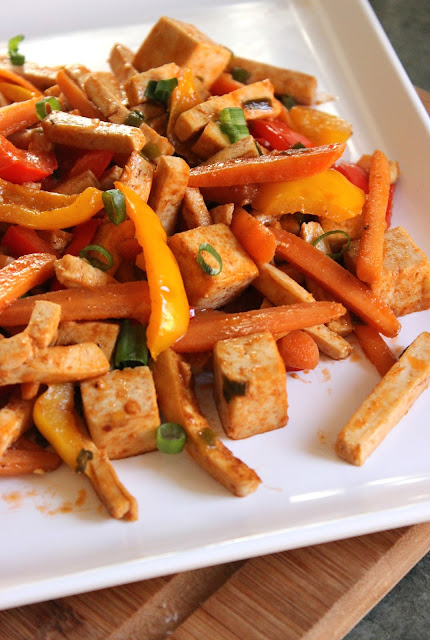 Sweet and Sour Tofu Stir Fry with bell peppers, baby carrots and sliced green onions