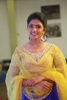 Actress Eesha in Yellow Choli Blue Ghagra at Darshakudu music launch 025.JPG