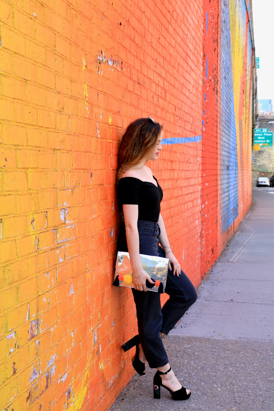 Fashion blogger Kathleen Harper wearing black high-waisted mom jeans from Urban Outfitters