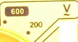 simbolo corriente alterna en polimetro