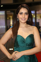 Raashi Khanna in Dark Green Sleeveless Strapless Deep neck Gown at 64th Jio Filmfare Awards South ~  Exclusive 144.JPG