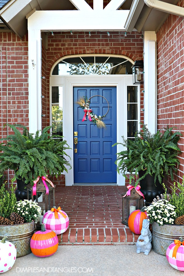 Sherwin Williams Dignity Blue, blue front door, fall porch, fall decorations, painted pumpkins, gingham pumpkin