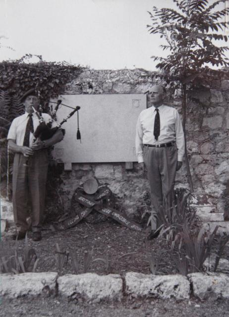 """Mad Jack"" Churchill, later in his life, playing the bagpipes at a memorial service. Photo from the late 1950s, Churchill stands by a stone memorial, flanked by another WWII veteran. Overstreet and Mad Jack and other stories of pilots. marchmatron.com"