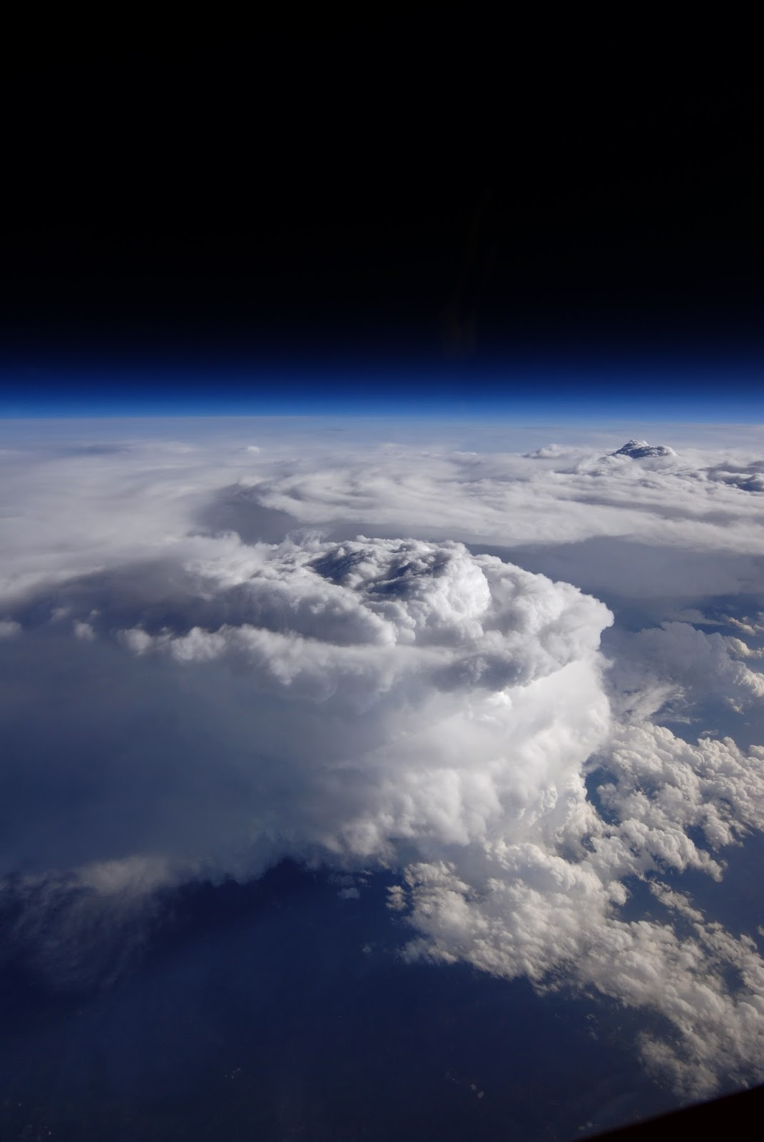 Storm Cell over the Southern Appalachian Mountains Storm Cell over the Southern Appalachian Mountains   This storm cell photo was taken from NASA's high-altitude ER-2 aircraft on May 23, 2014, during a study aimed at gaining a better understanding of precipitation over mountainous terrain. The Integrated Precipitation and Hydrology Experiment, or IPHEx, field campaign is part of the ground validation effort for the Global Precipitation Measurement (GPM) mission, an international satellite mission led by NASA and the Japan Aerospace Exploration Agency. GPM's Core Observatory launched Feb. 27, 2014, to provide next-generation observations of rain and snow worldwide every three hours. But to get accurate measurements from space, scientists have to understand what is happening on the ground.  For the six-week IPHEx field campaign over the southern Appalachian mountains, the NASA team and their partners at Duke University and NOAA's Hydrometeorological Test Bed set up ground stations with rain gauges and ground radar throughout western North Carolina. In addition to the ground sites, they also collected data sets from satellites and two aircraft.  The NASA ER-2 aircraft that deployed to Robins Air Force Base in Warner Robins, Georgia, was able to fly when rain was in the air. The ER-2's cruising altitude of 65,000 feet kept it well above the storm systems it was observing, allowing it to act as a proxy-satellite. The aircraft carried a suite of instruments, including three that took measurements similar to those taken by GPM's Core Observatory.  Image Credit: NASA / Stu Broce Explanation from: http://www.nasa.gov/content/storm-cell-over-the-southern-appalachian-mountains/