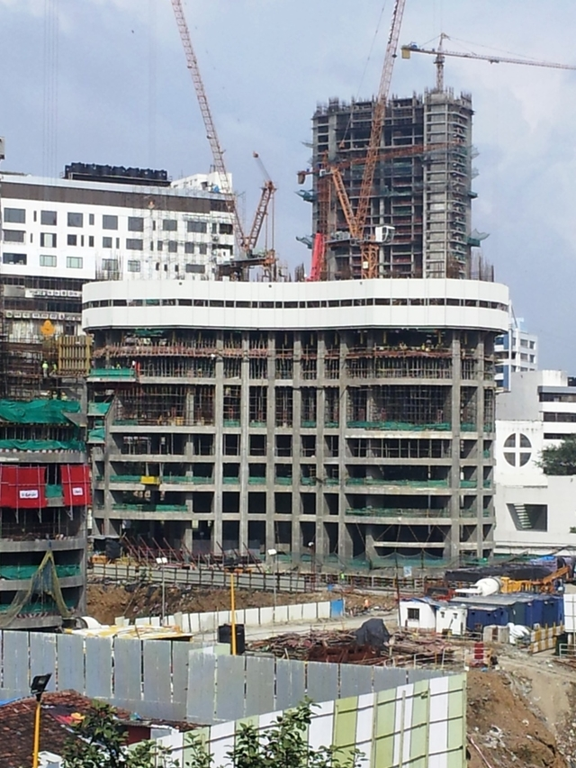 Close up photo of lower building under construction