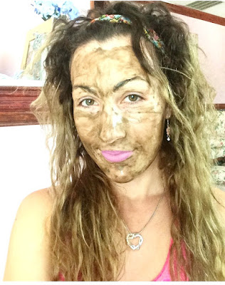 face with deep cleansing diy bentonite clay mask on it